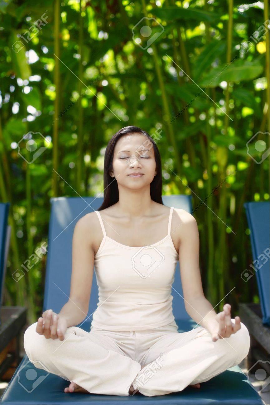 Sensational Young Asian Female Meditating On A Reclining Chair Creativecarmelina Interior Chair Design Creativecarmelinacom