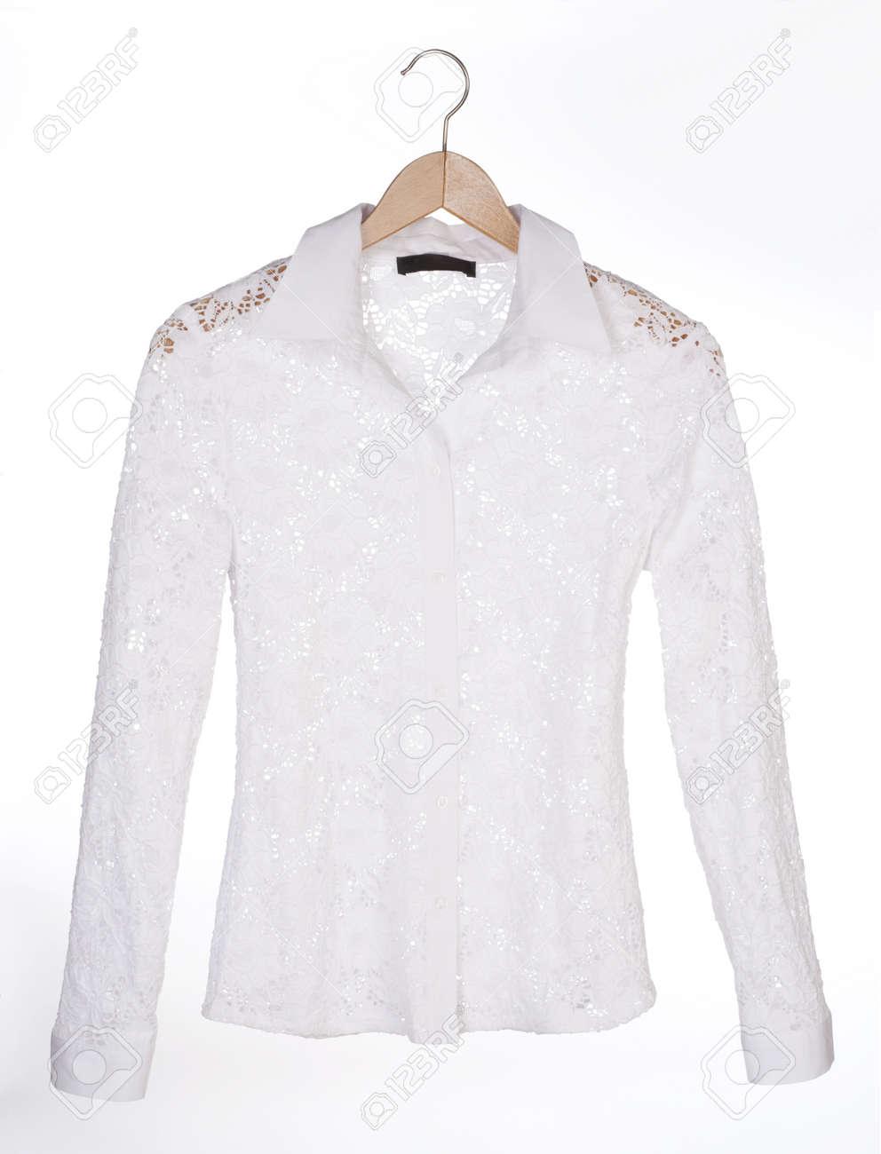 Weiße Spitzenbluse Auf Einem Kleiderbügel Lizenzfreie Fotos, Bilder ...