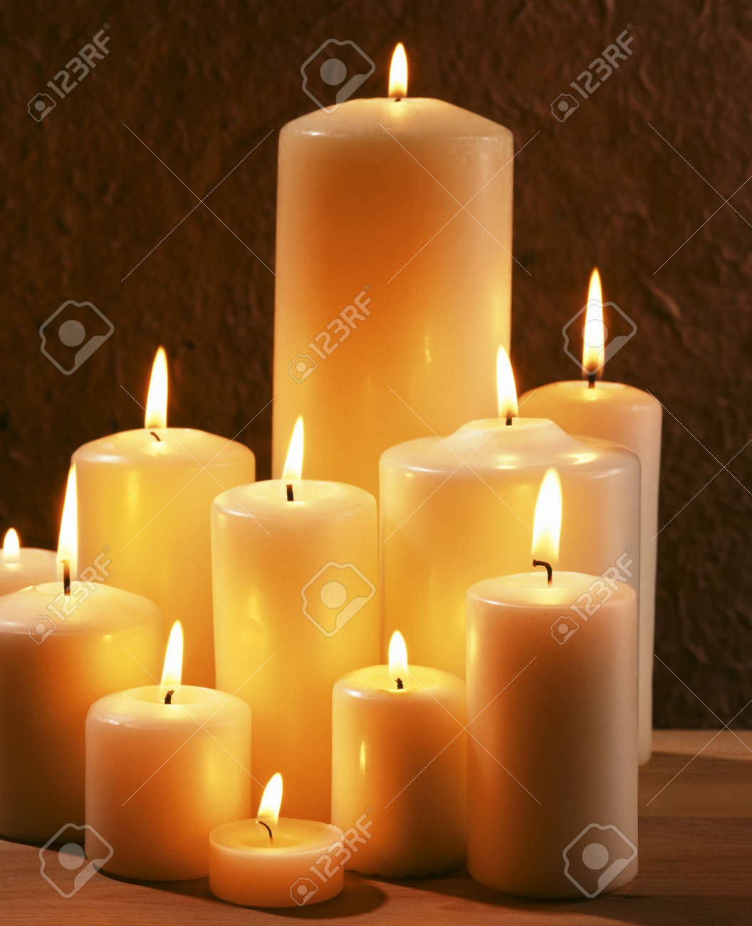 Group of burning candles at a dark background Stock Photo - 20752460