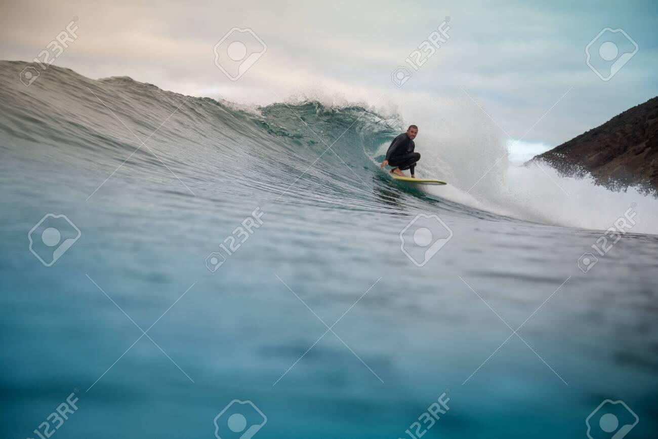 surfer riding waves on the island of fuerteventura - 138648553