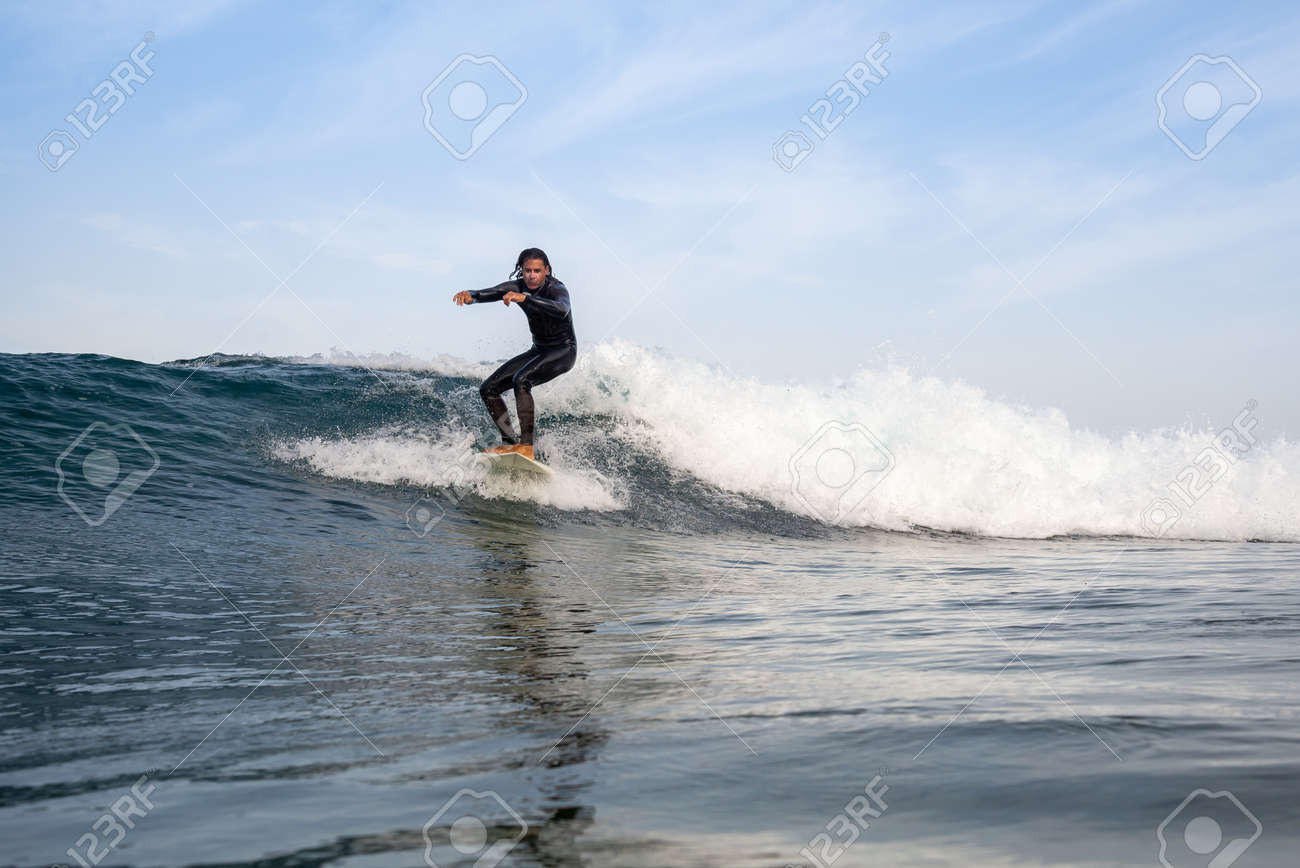 Surfer riding waves on the island of fuerteventura in the Atlantic Ocean, Canary Islands - 139118304