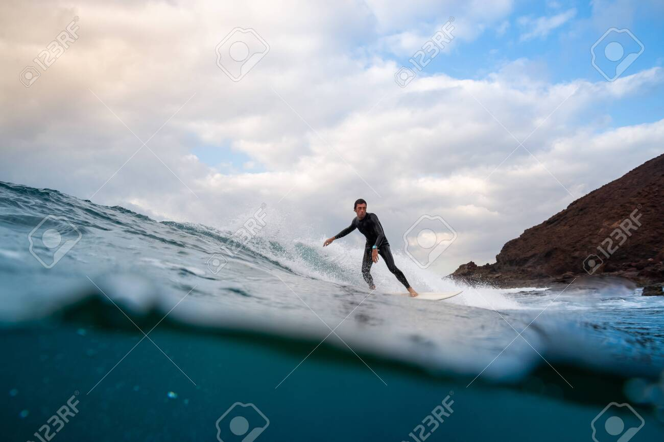 Surfer riding waves on the island of fuerteventura in the Atlantic Ocean, Canary Islands - 139618257