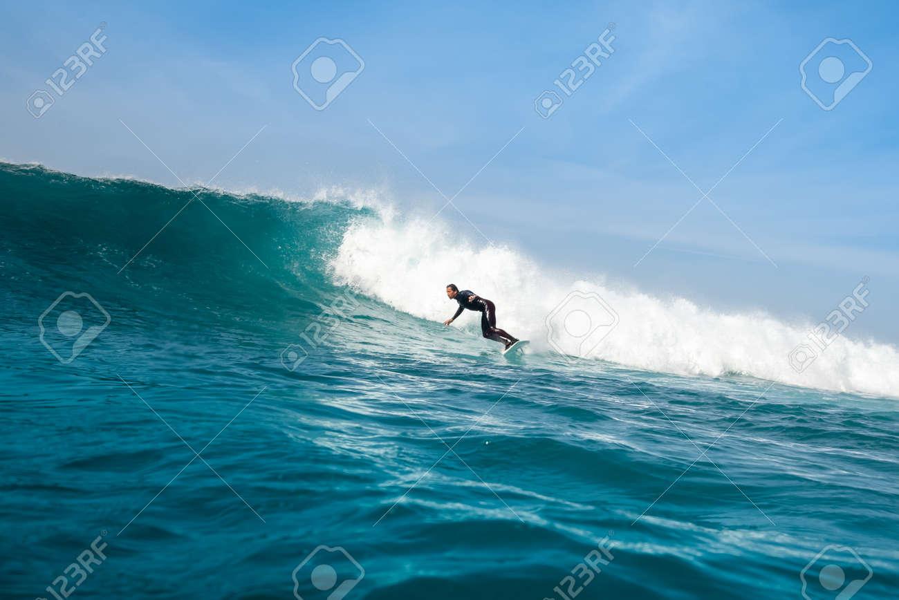 Surfer riding waves on the island of fuerteventura - 141805415