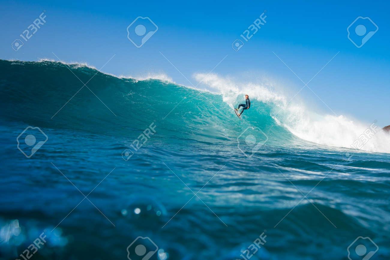 Surfer riding waves on the island of fuerteventura - 141805421