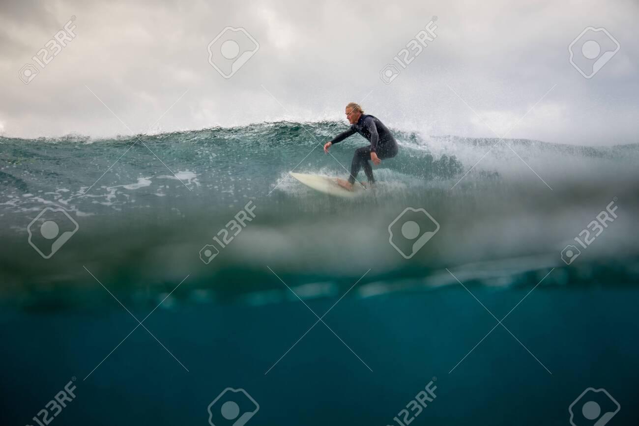 Surfer riding waves on the island of fuerteventura - 141805424
