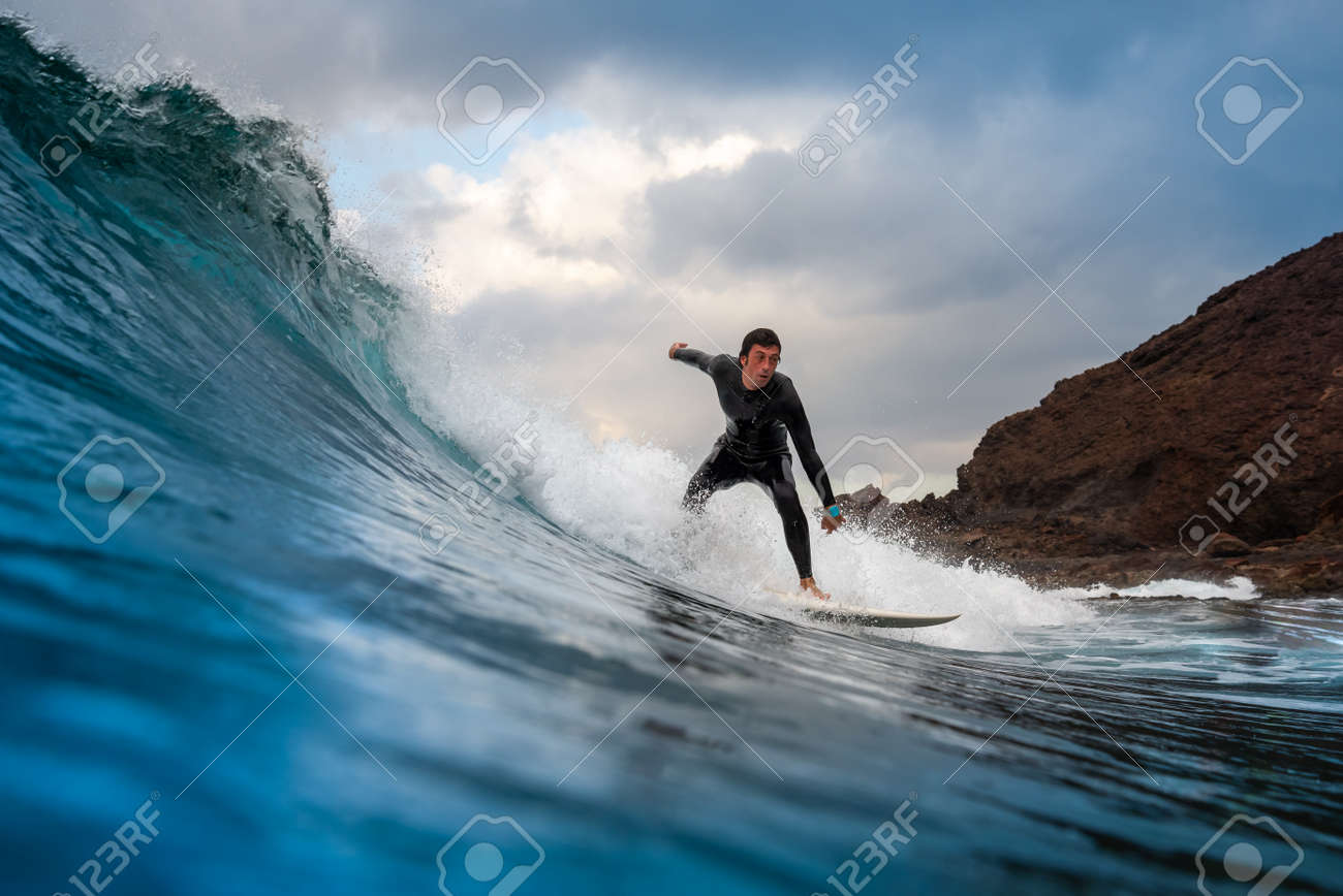 Surfer riding waves on the island of fuerteventura in the Atlantic Ocean, Canary Islands - 140114374