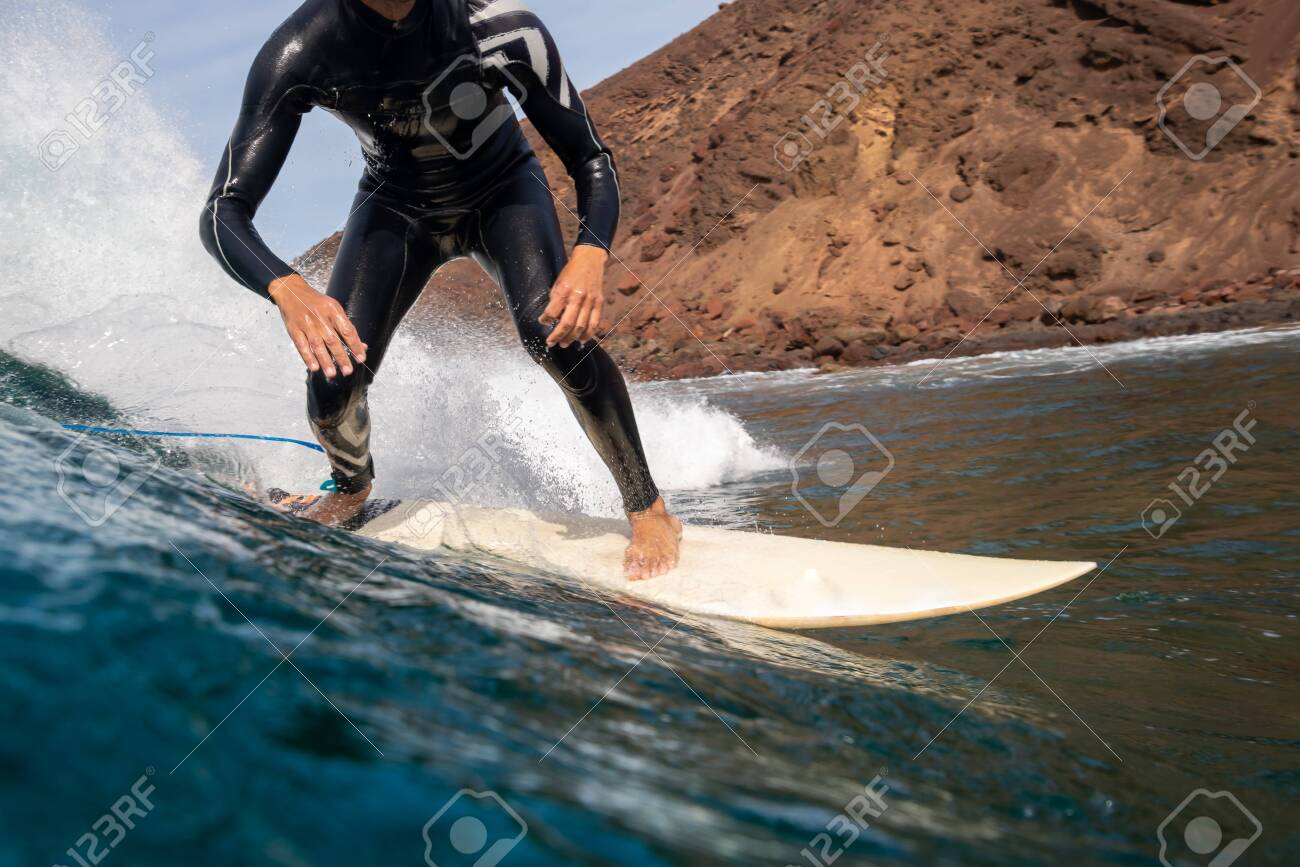 Surfer riding waves on the island of fuerteventura in the Atlantic Ocean, Canary Islands - 140634111