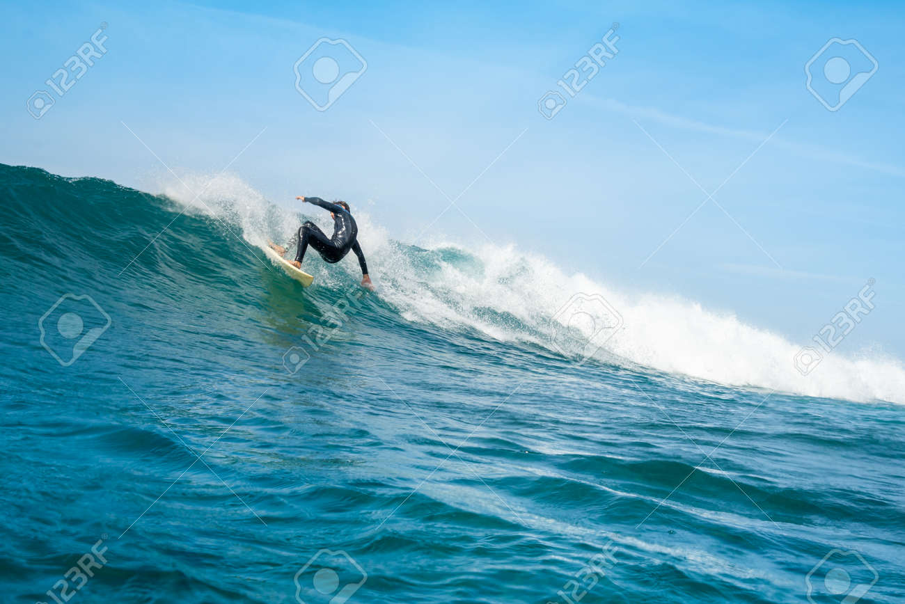 Surfer riding waves on the island of fuerteventura in the Atlantic Ocean, Canary Islands - 140634112