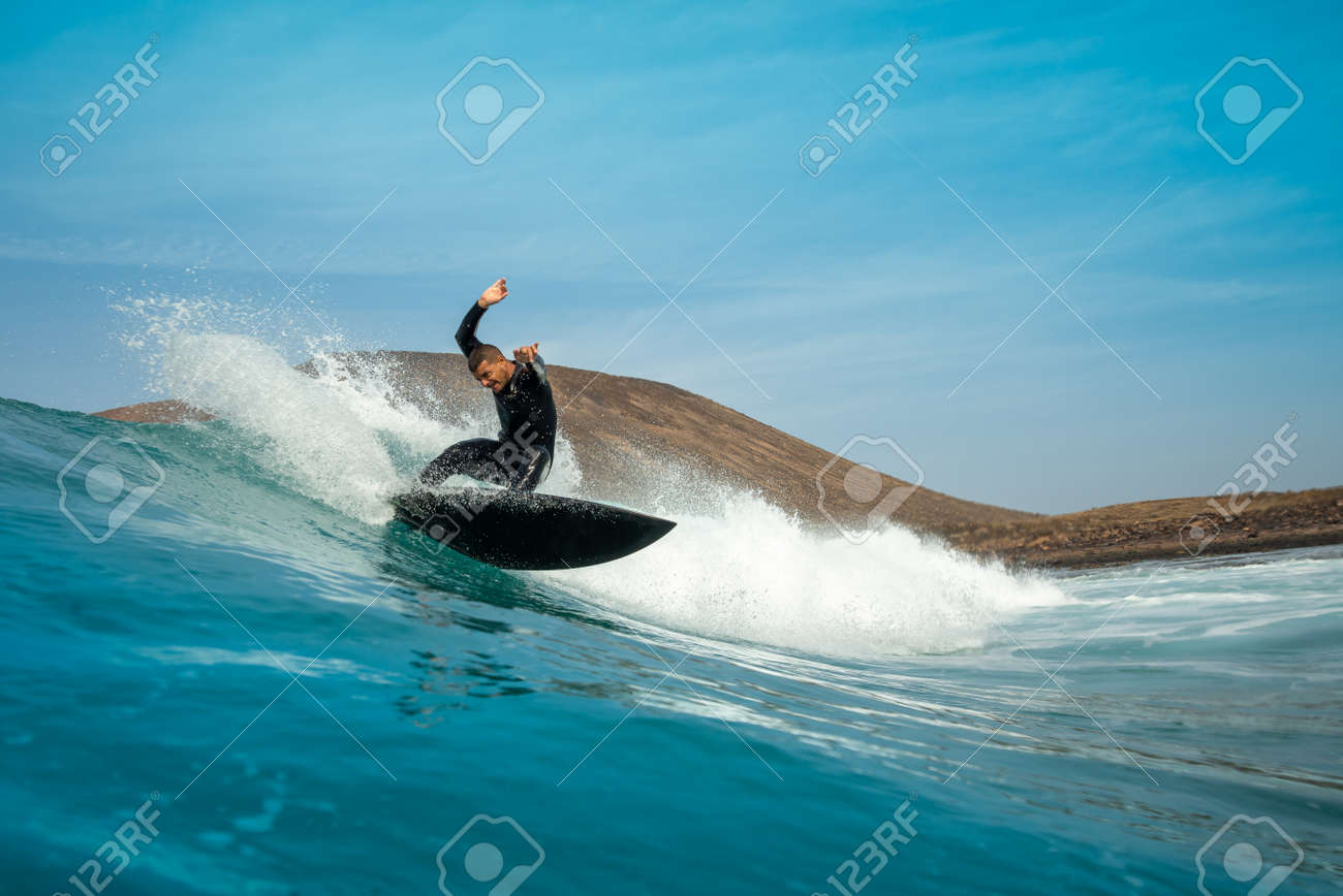 Surfer riding waves on the island of fuerteventura in the Atlantic Ocean, Canary Islands - 140667872
