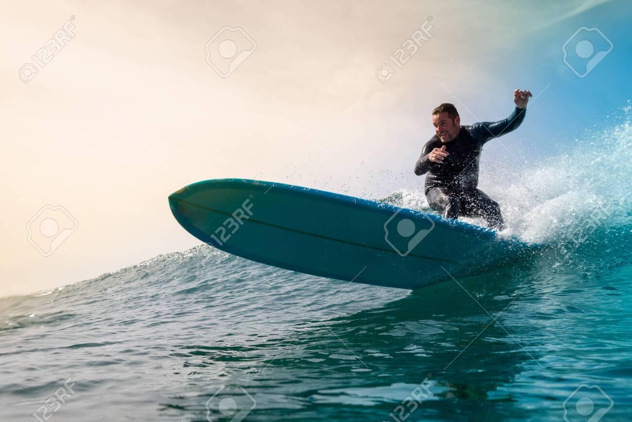 Surfer riding waves on the island of fuerteventura - 142109347