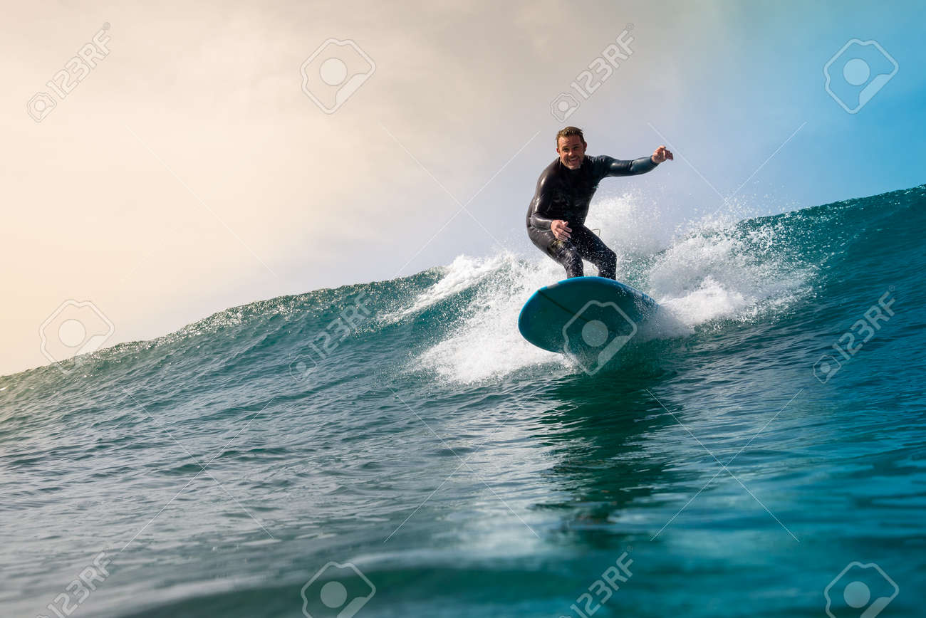 Surfer riding waves on the island of fuerteventura in the Atlantic Ocean, Canary Islands - 142103977