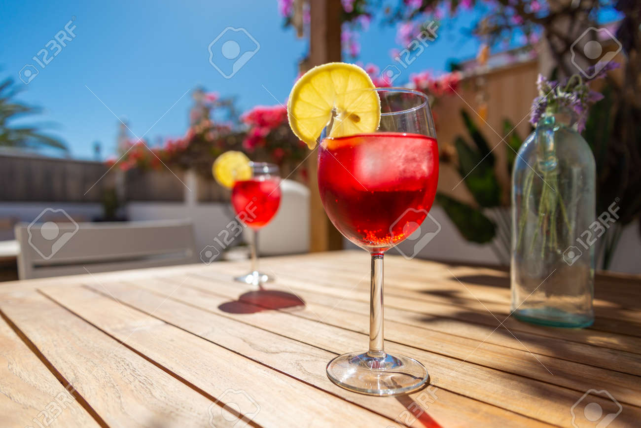 Refreshing Tropical Cocktail Drink on a table in the garden - 143208184
