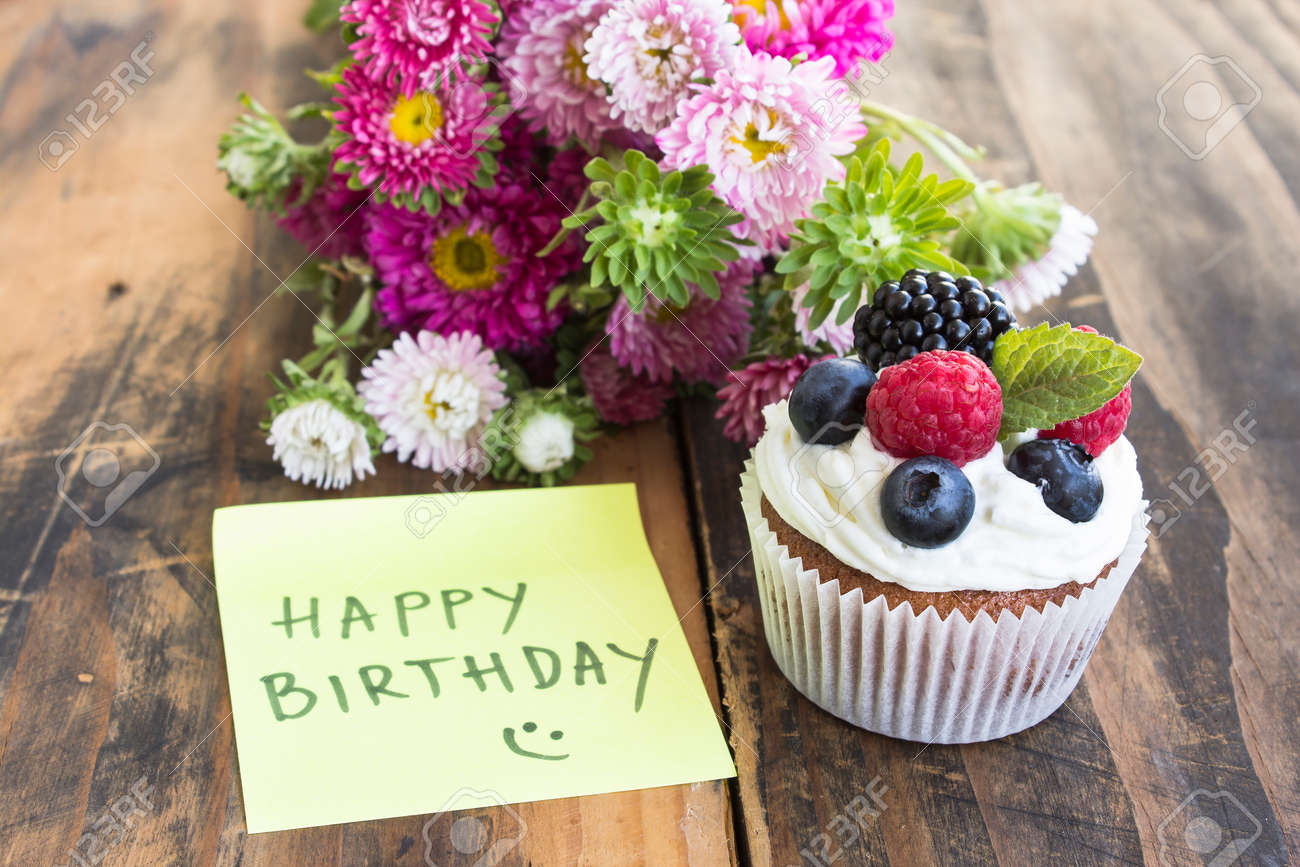 Delicious Cupcake With Happy Birthday Notepaper And Flowers Stock