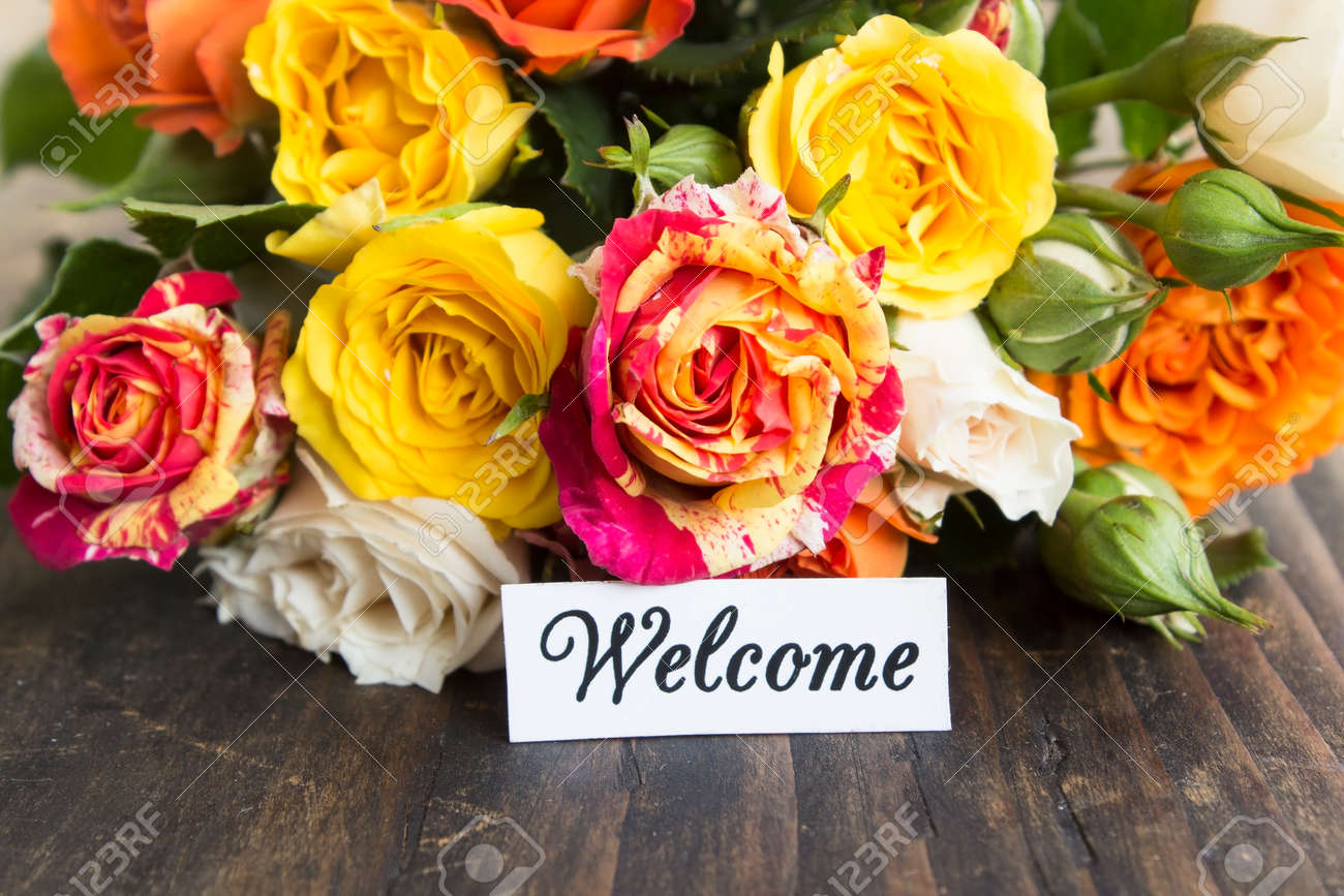 Welcome Card With Bouquet Of Multicolored Roses On A Rustic Wooden