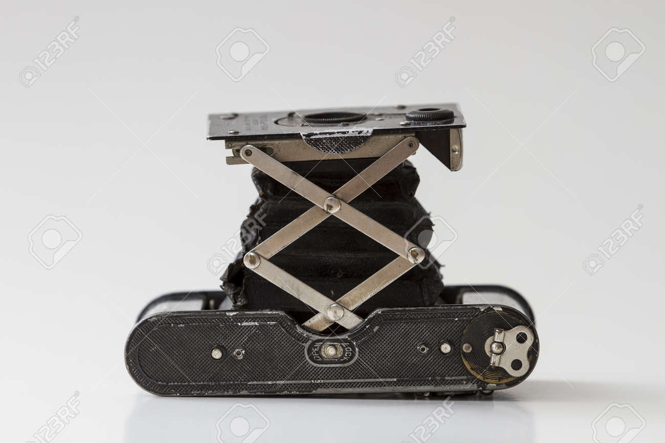 Old antique analogue camera isolated, detail, closeup  Aged, object  History  Negative Stock Photo - 20284739