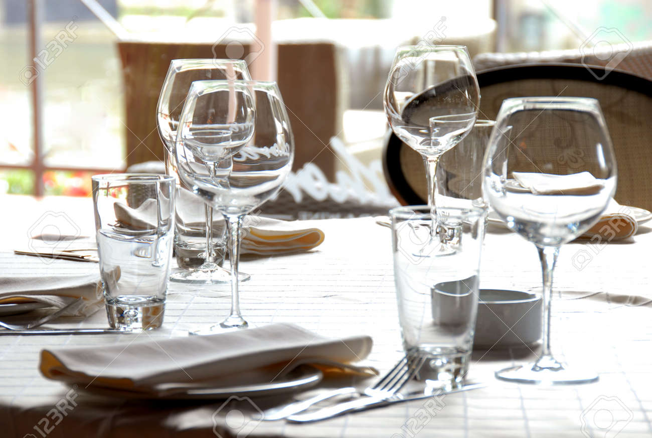 wine glasses and plates served at dinner table in restaurant Stock Photo - 7161676