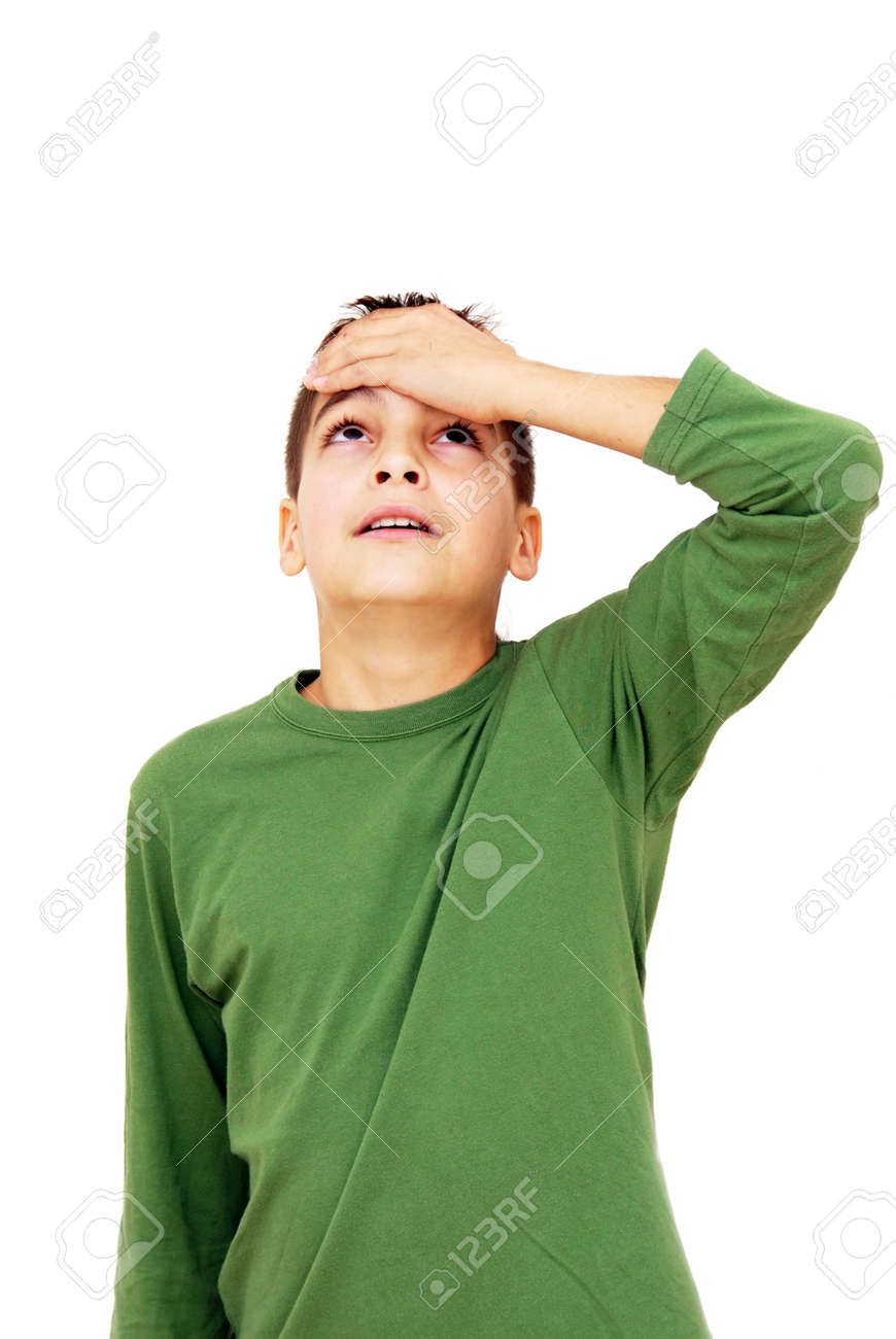 teenage boy with arm on forehead isolated on white Stock Photo - 8385191