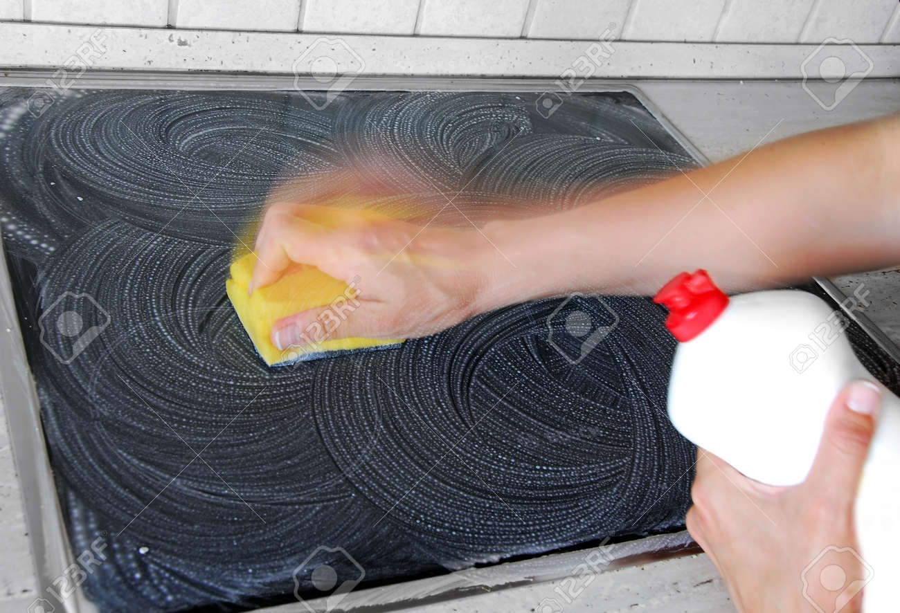hand with a sponge cleaning surface in kitchen - 10313840