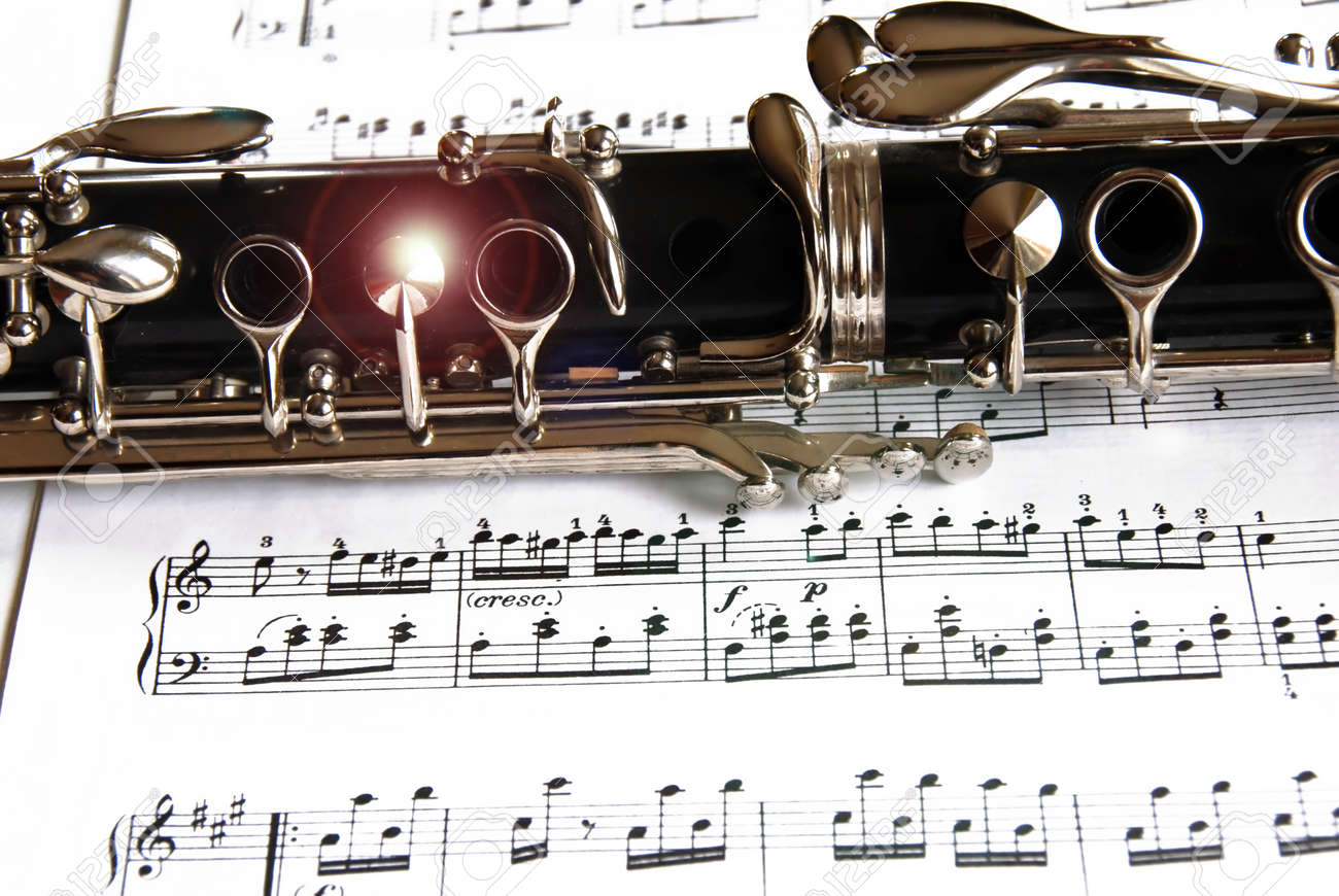 Fragment of black shining clarinet over opened music book Stock Photo - 10396583