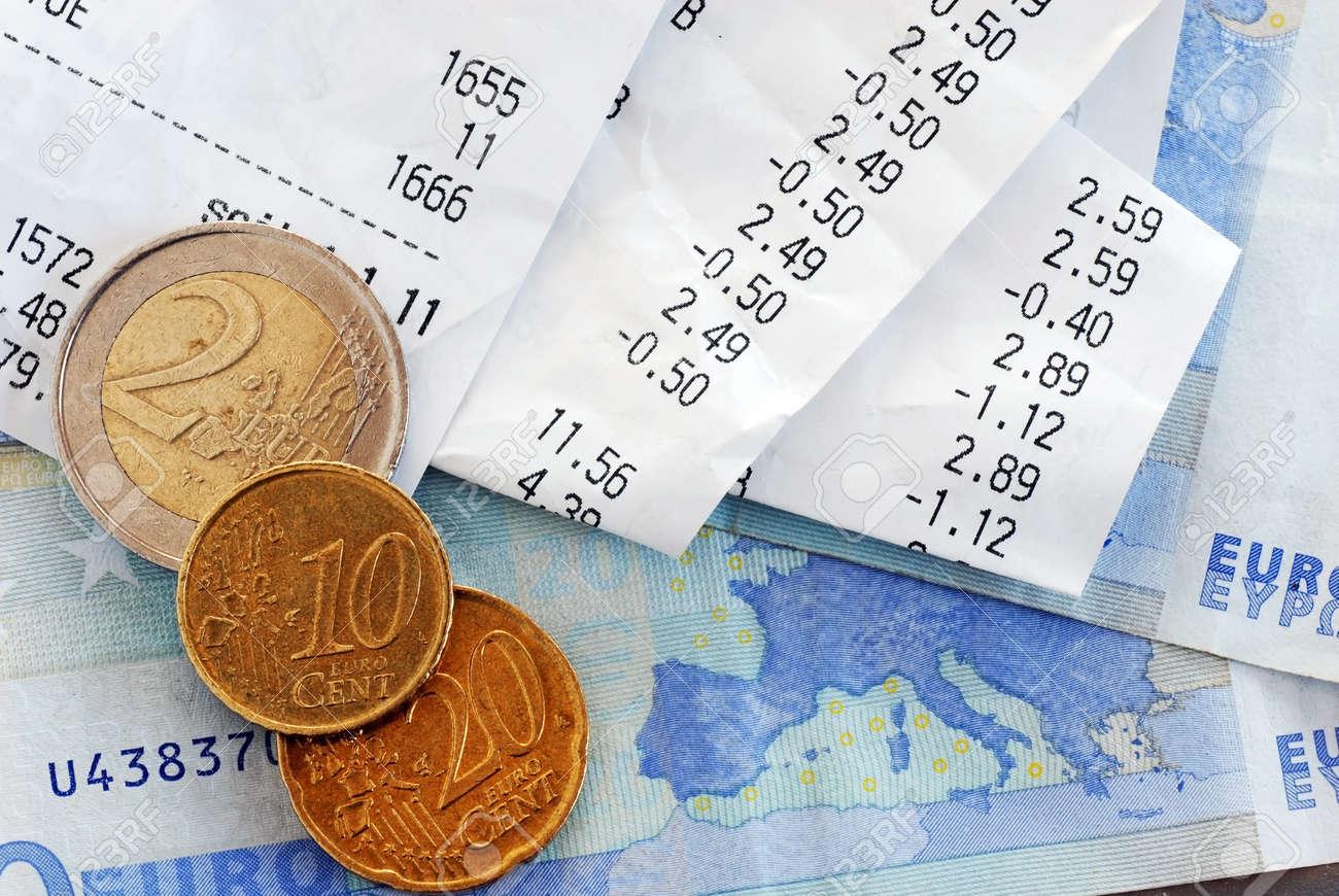 closeup of bills and euro banknotes and coins macro - 11932345