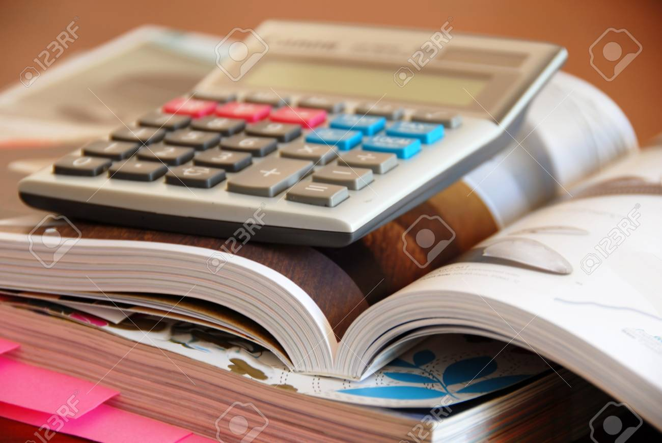 two opened dense catalogs and calculator closeup Stock Photo - 12467213