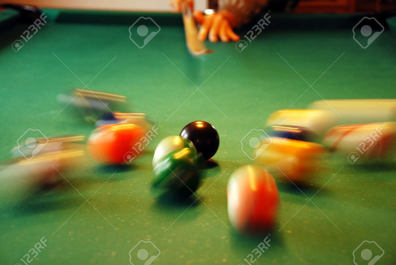 Pool Table Balls Scattered Stock Photo - cue shooting at