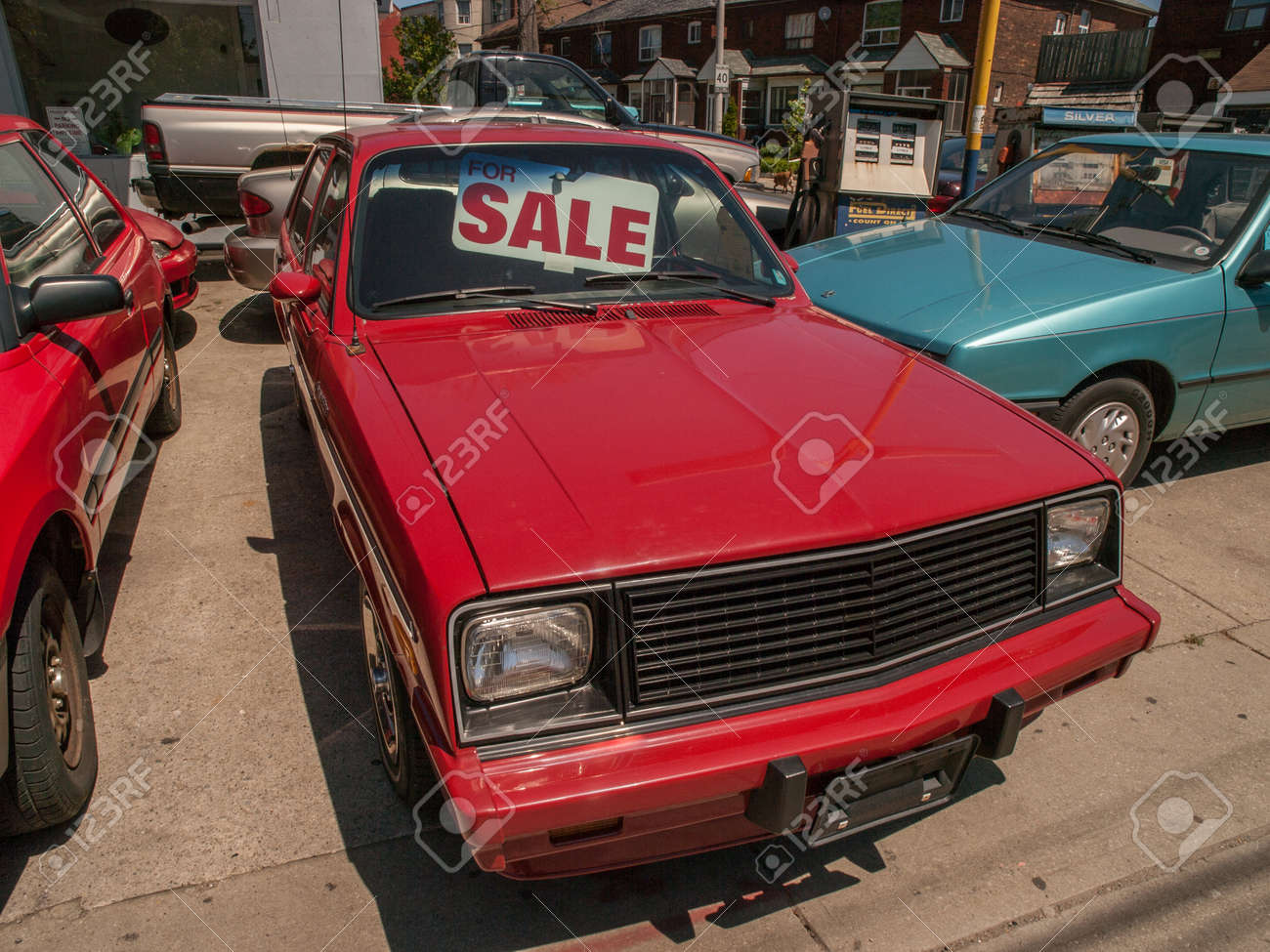 Old Red Hatchback Car For Sale In A Used Car Lot In Toronto Ontario ...