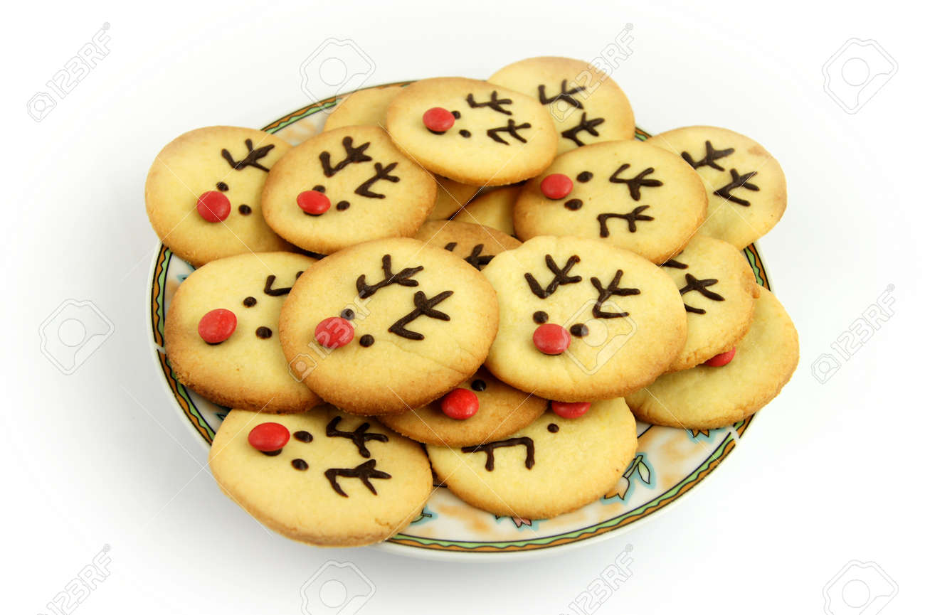 Christmas Reindeer Cookies On Plate Isolated On White