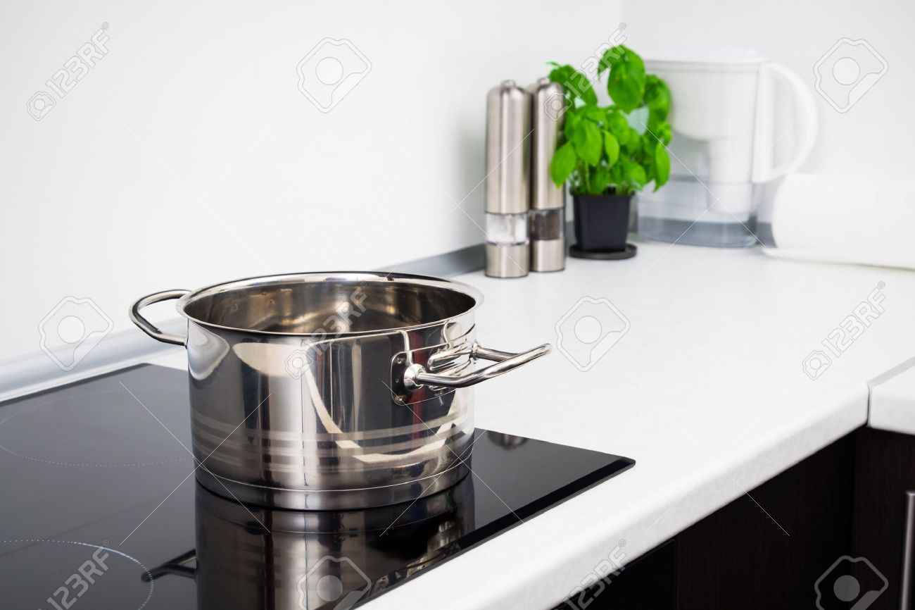 Modern Kitchen Stove pot in modern kitchen with induction stove stock photo, picture