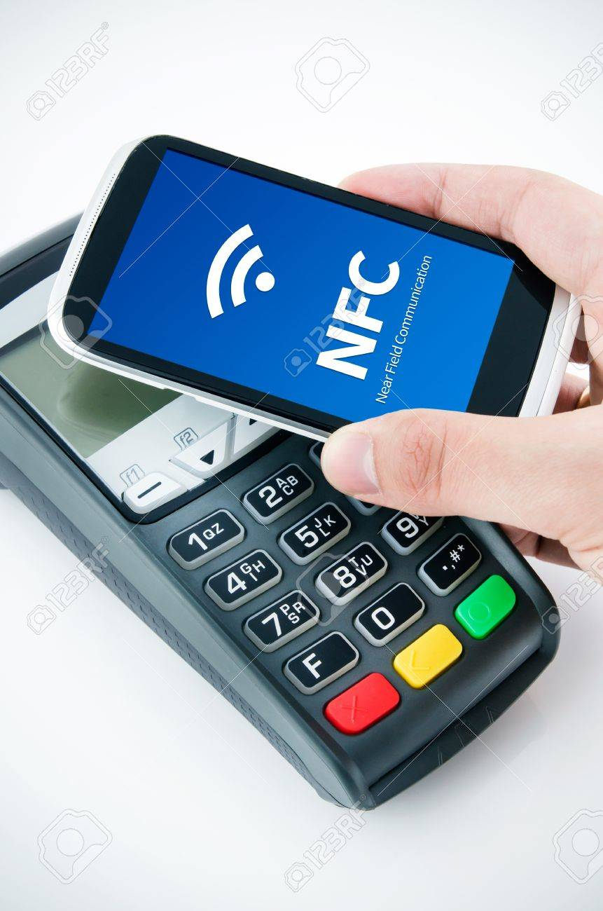 Contactless Payment Card With NFC Chip In Smart Phone Stock