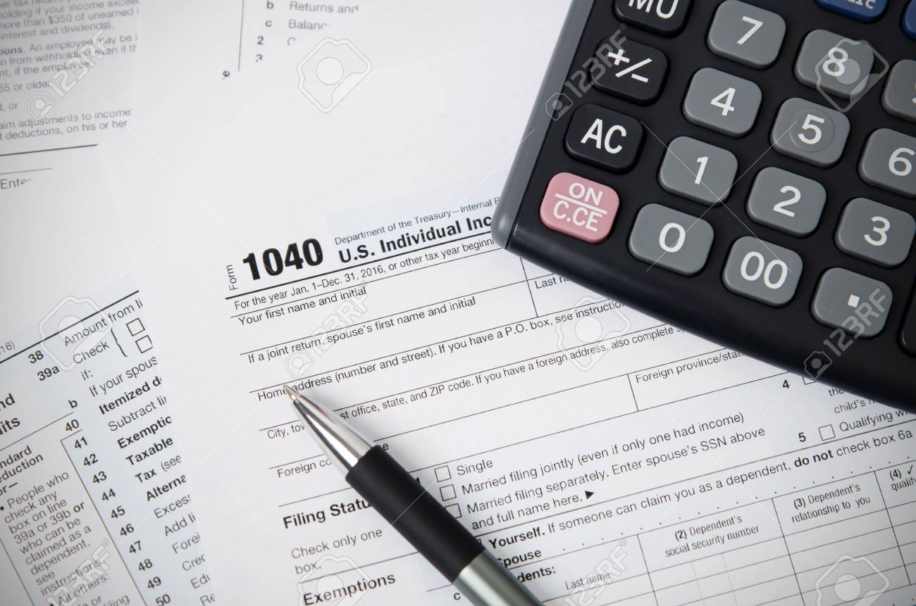 form 1040 calculator  US tax form 6 with pen and calculator. tax form law document..