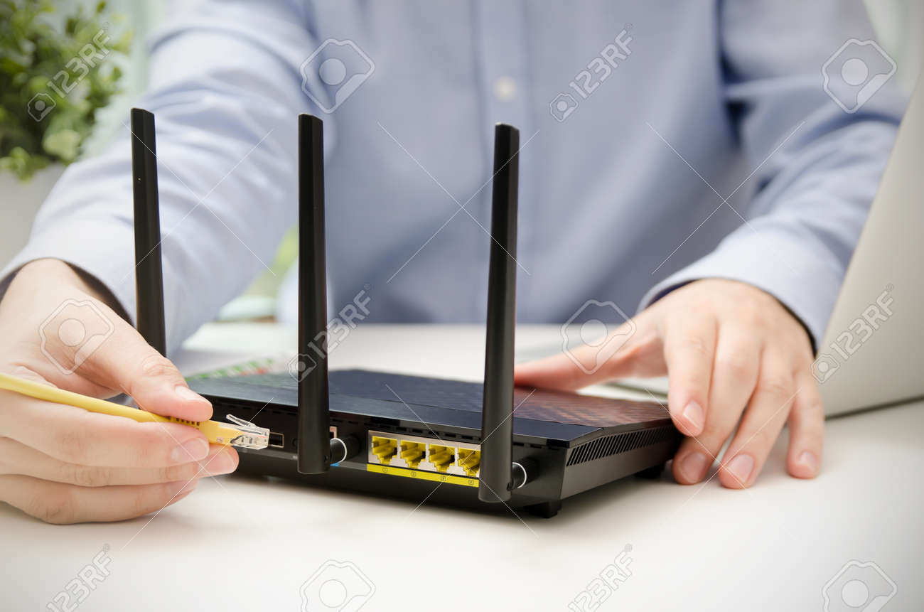 Pleasant Man Plugs Ethernet Cable Into Router Router Wireless Wire Broadband Wiring Cloud Intapioscosaoduqqnet