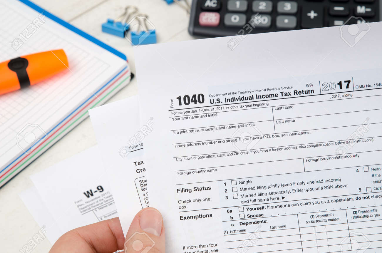 Man Holding Us Tax Form 1040 Tax Form Law Document Irs Business