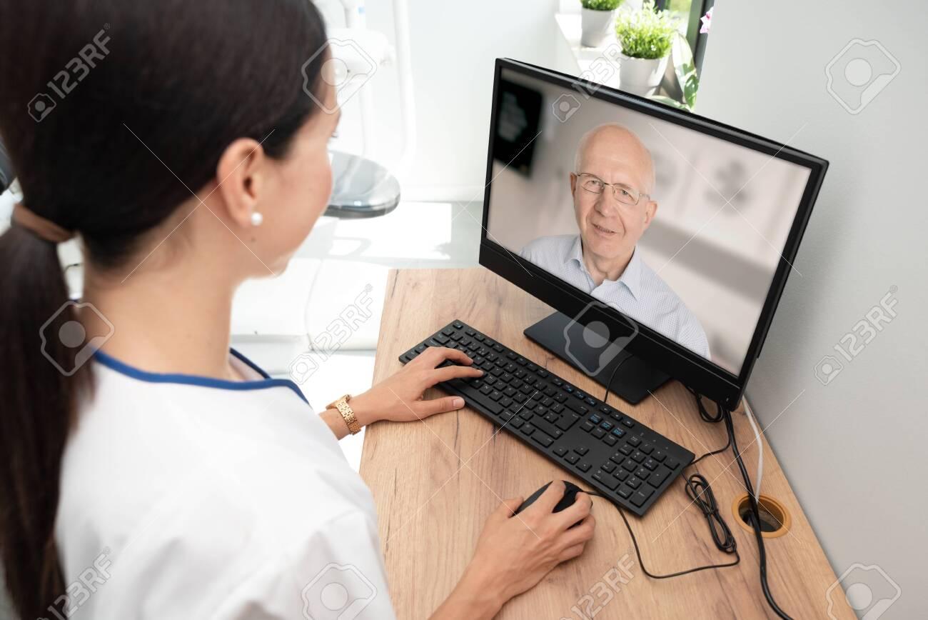 Doctor and senior man patient medical consultation, telehealth, telemedicine, remote health care concept. - 129754752