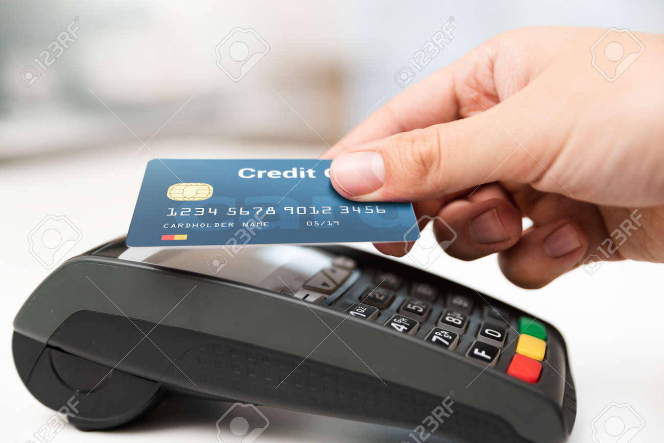 Man using credit card in shop. Cashless payment with pos terminal - 141701025