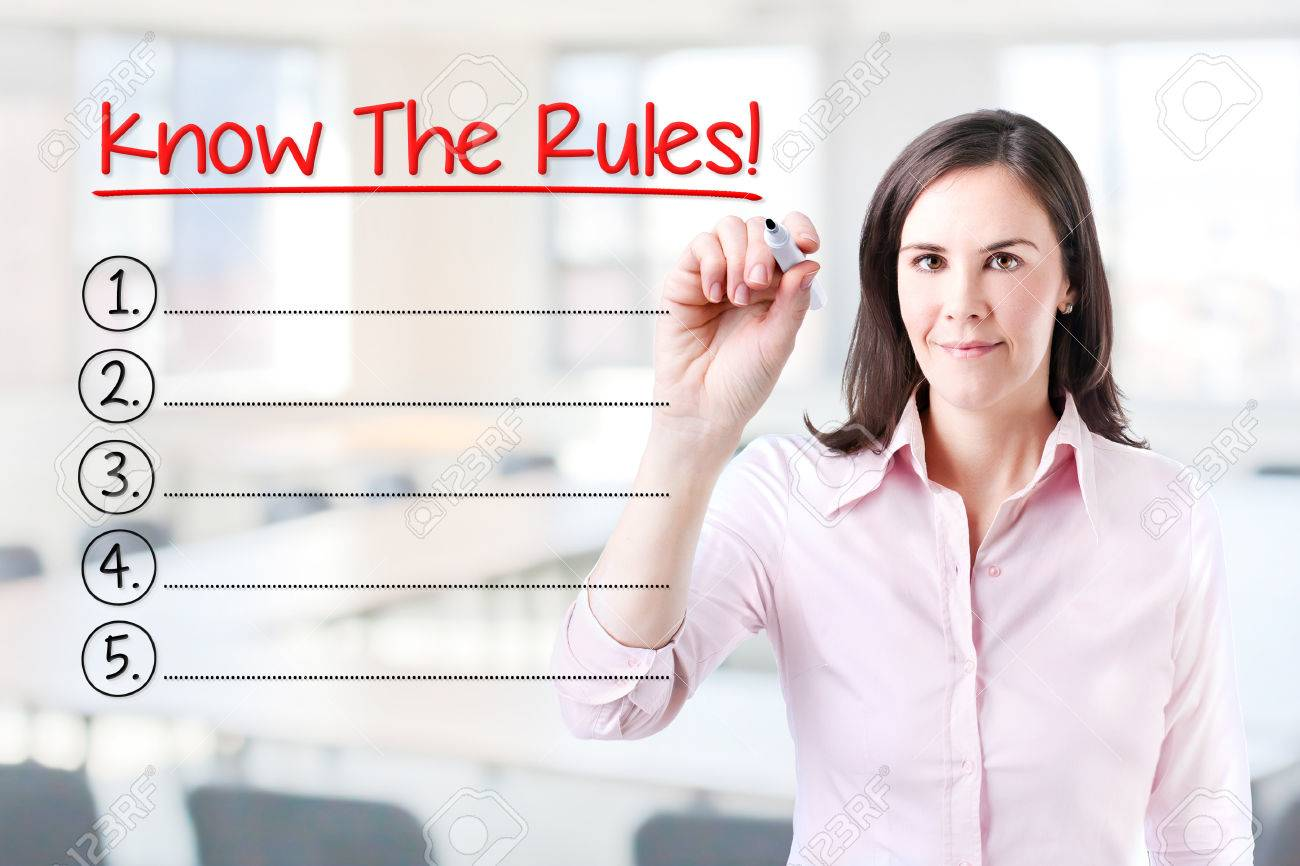 Business woman writing blank Know The Rules! List. Office background. - 55263055