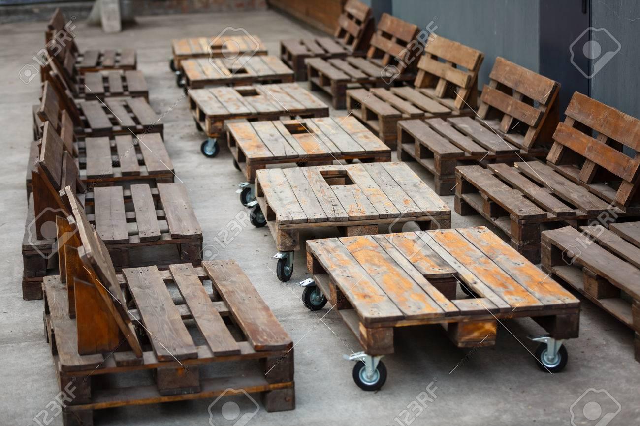 Empty Wooden Pallet In Loft Interior With Grunge Walls Decor