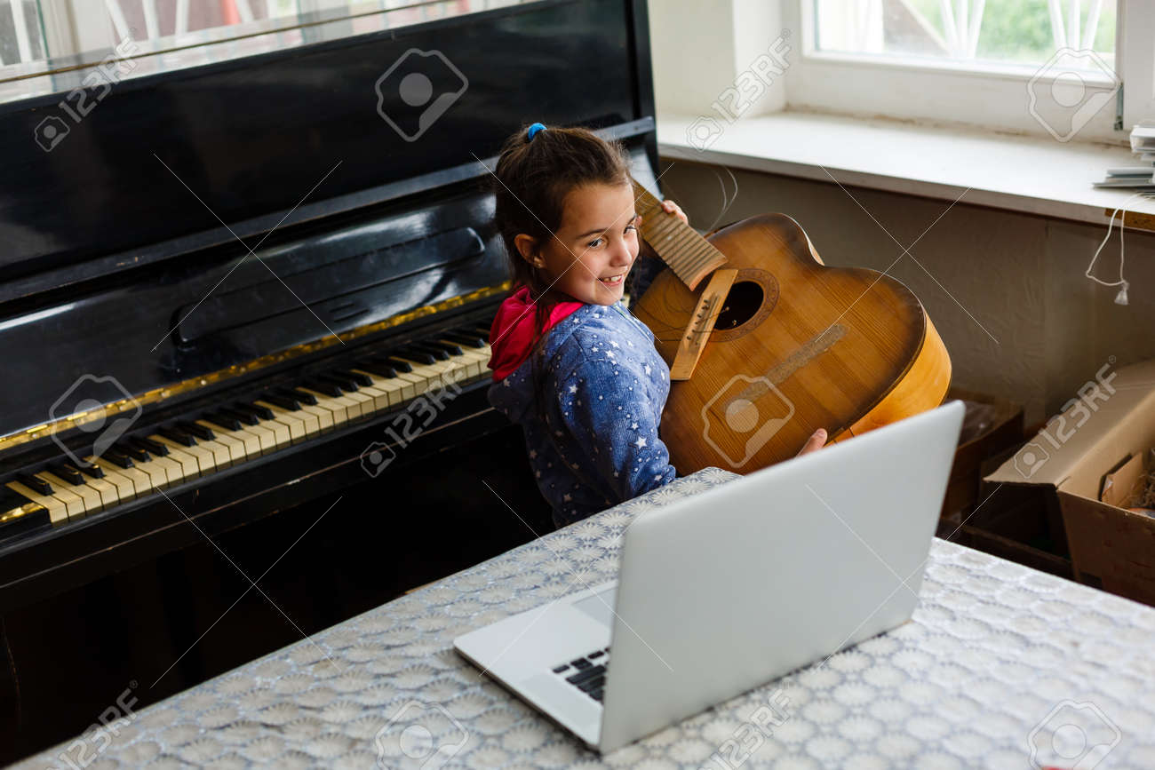little girl holding a broken guitar, guitar repair - 162160371