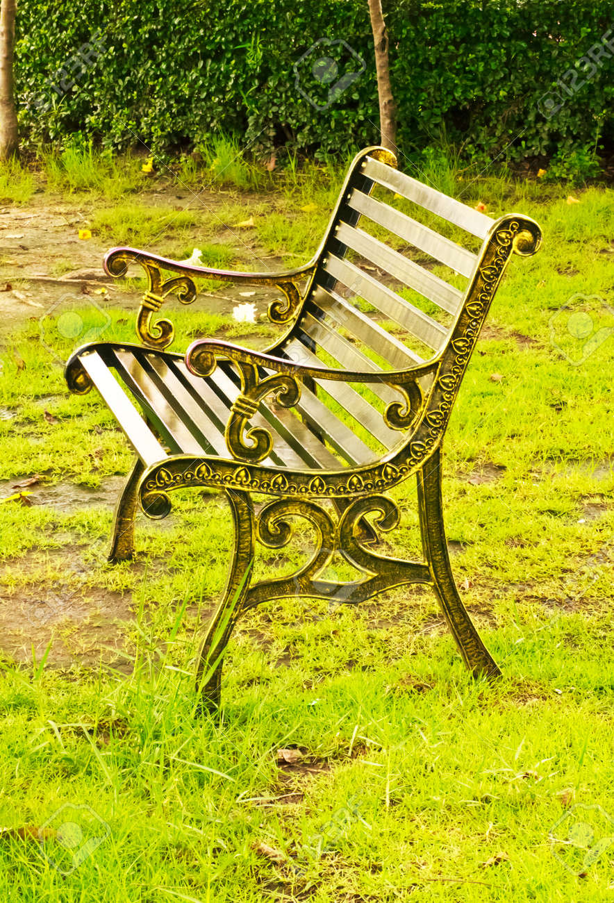 metal garden chair in beautiful garden stock photo, picture and