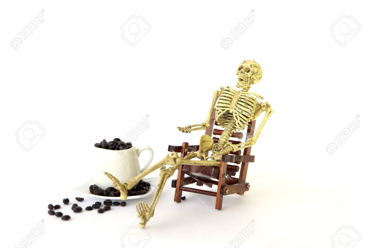 human skeleton sit on a chair on white background stock photo
