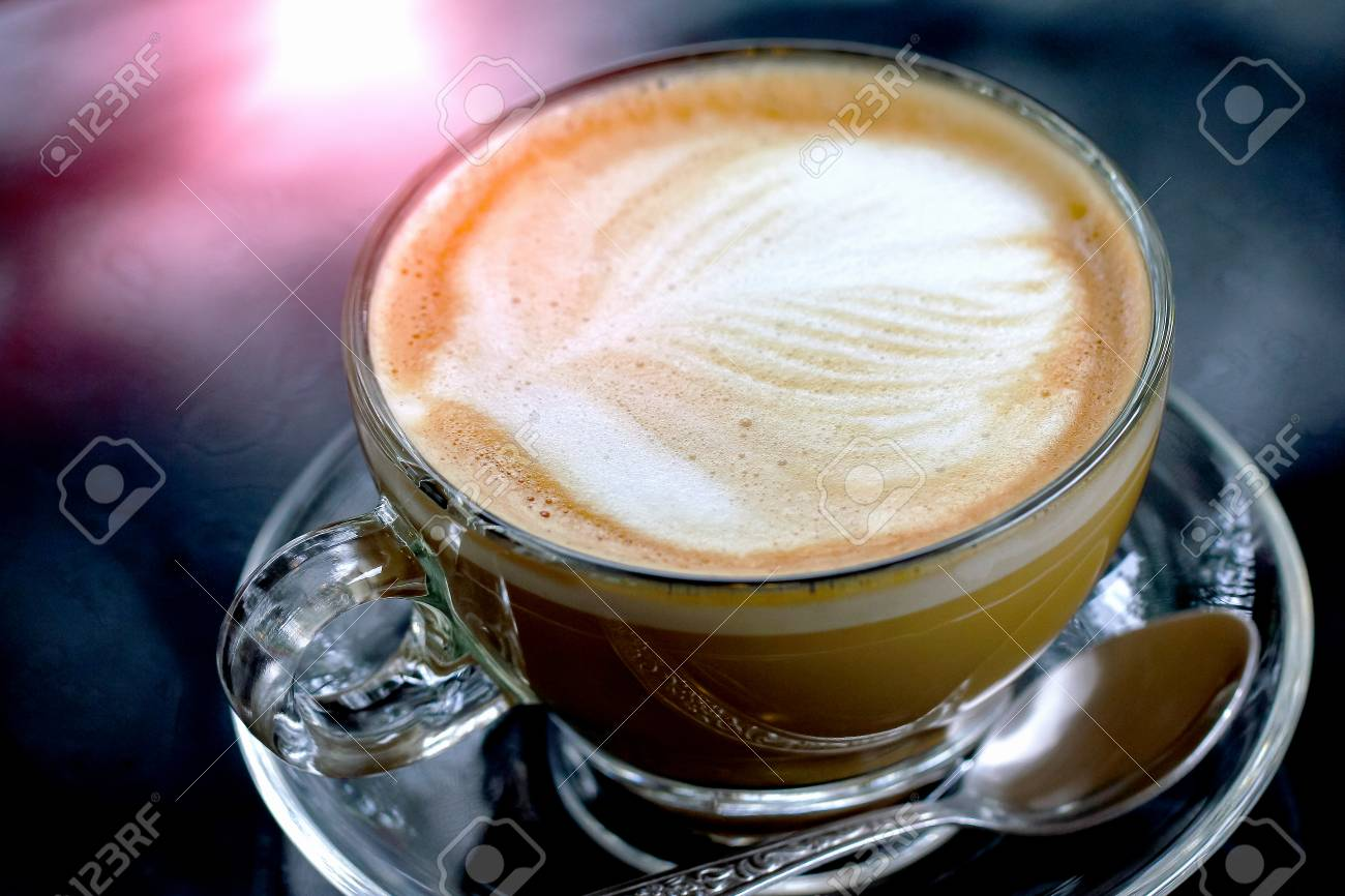Cappuccino Or Latte Coffee In A Clear Glass Mug On Table Stock Photo Picture And Royalty Free Image Image 118172960