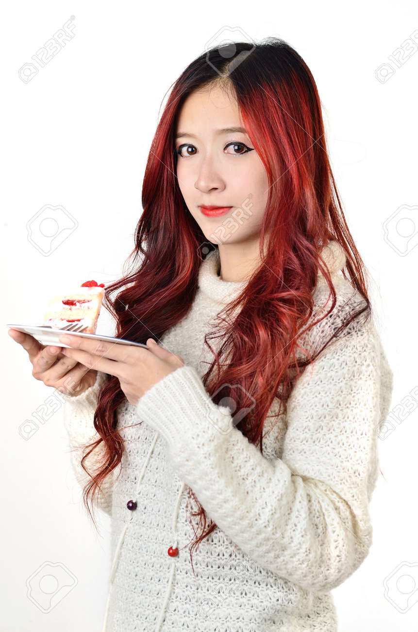 Close Up Beautiful Asian Women With Red Long Hair Eating Cake Stock