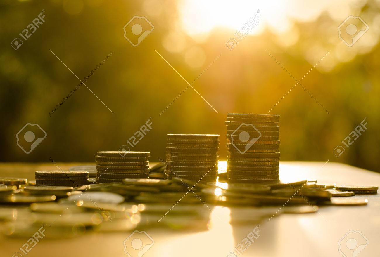 Money coin stack growing graph with sunlight - 36333072