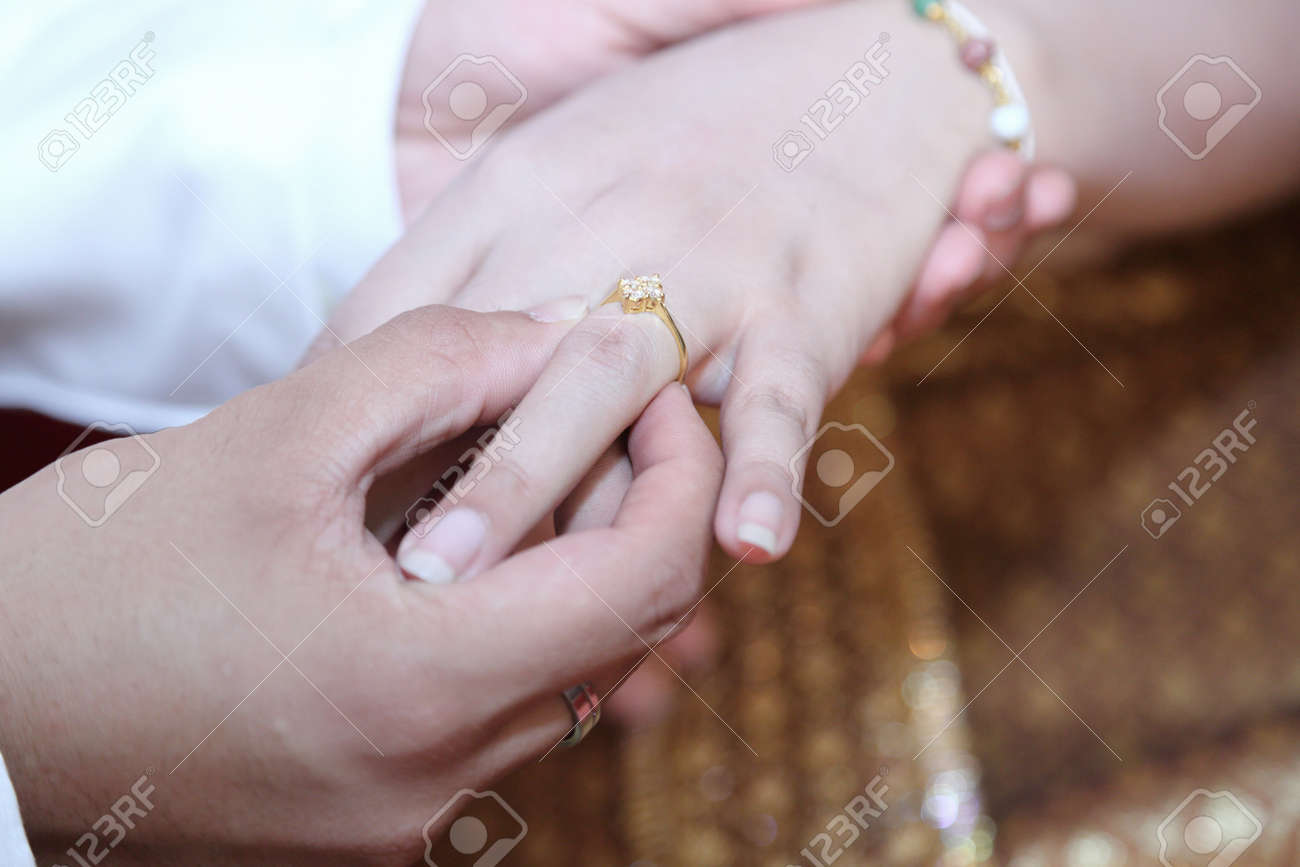 The Groom Wearing Wedding Ring For His Bride Stock Photo Picture