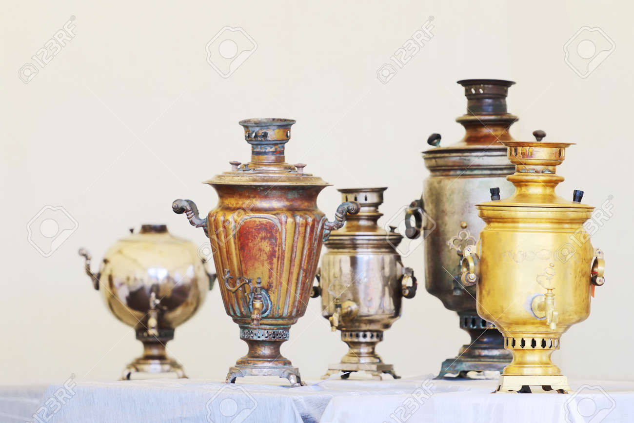 Five russian samovars of different shapes and sizes are on table five russian samovars of different shapes and sizes are on table with blue tablecloth stock photo reviewsmspy