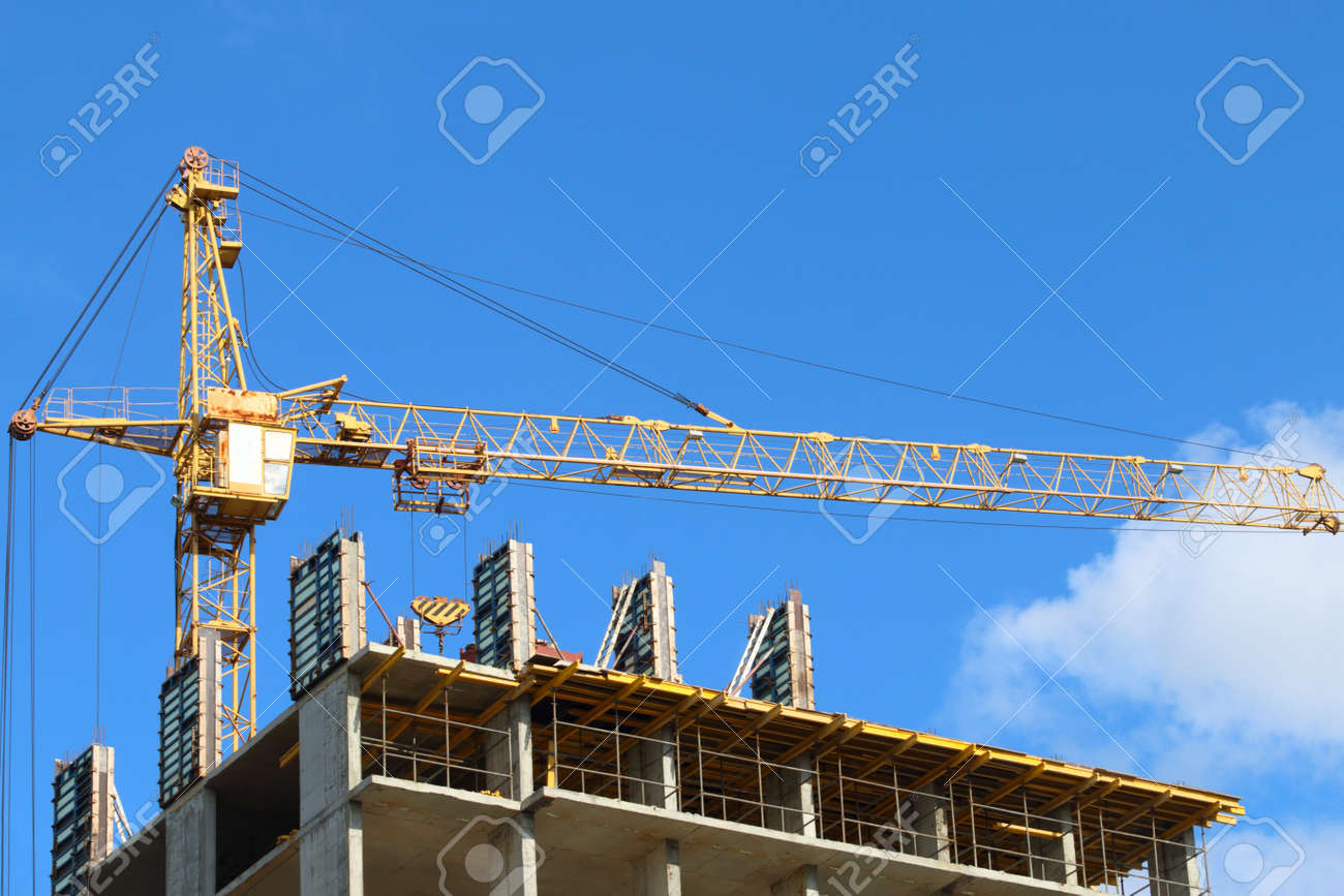 Big Yellow Stationary Hoist On Construction Site Part Of Building