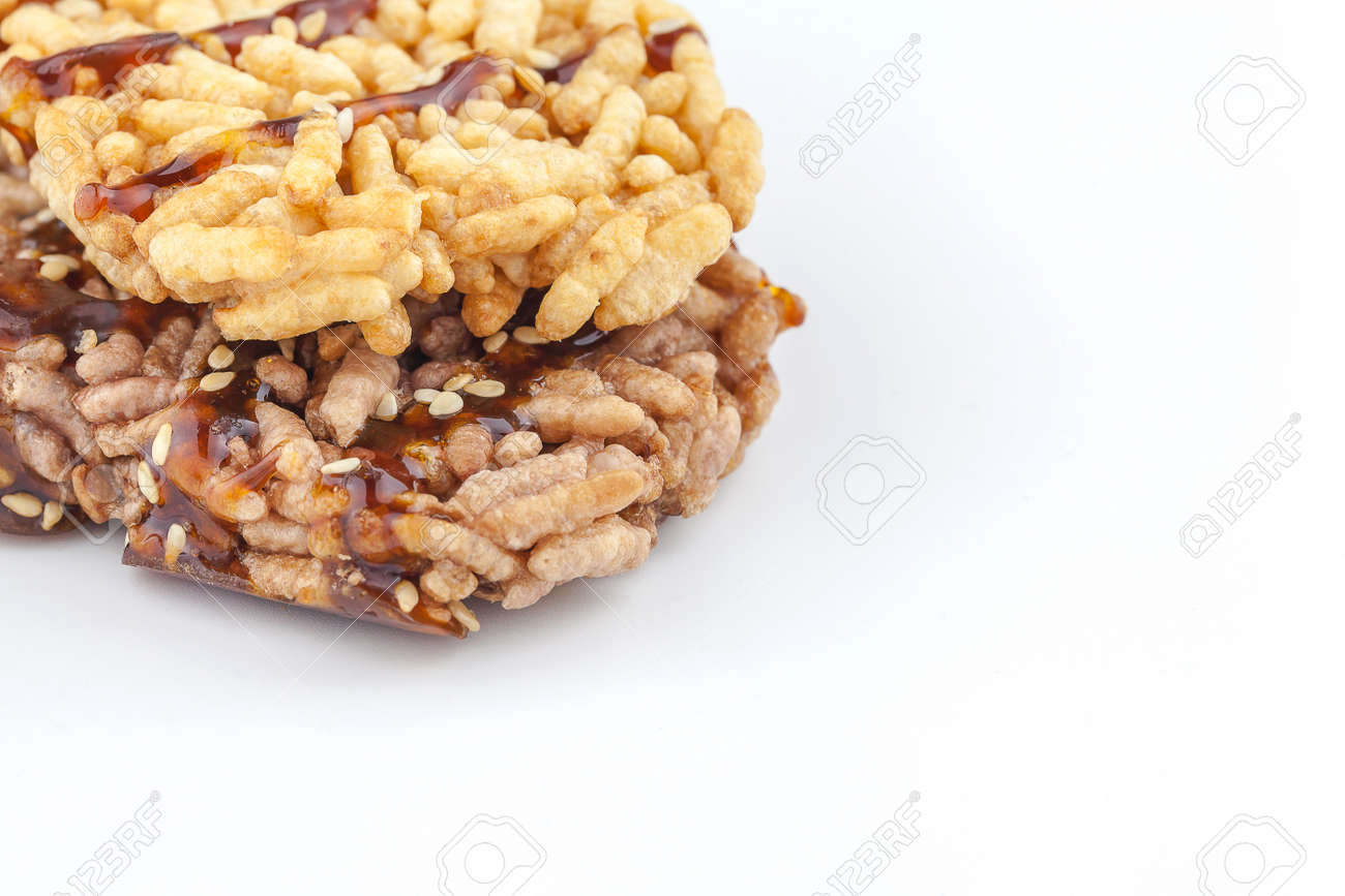 thai rice snack called rice taen with caramel on white background - 71018106