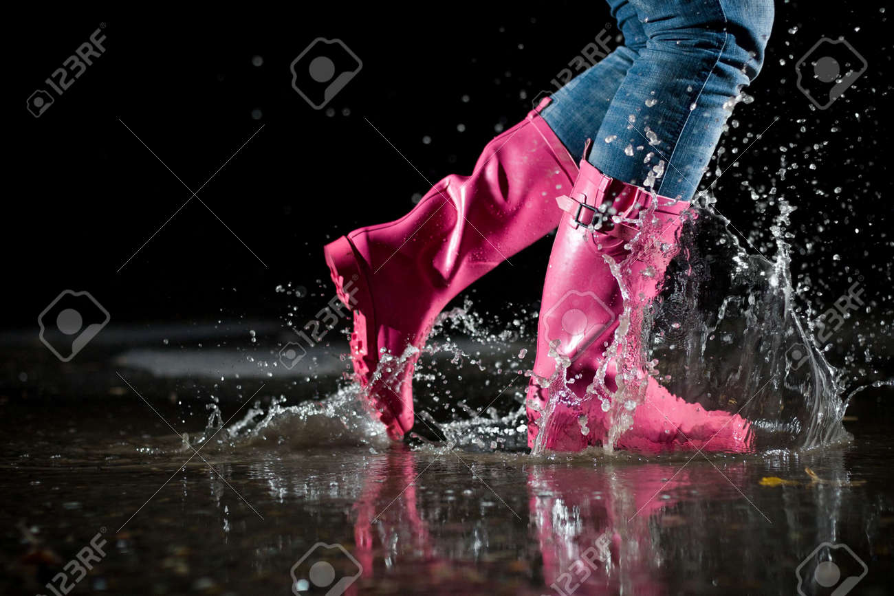 girl jumping in the puddle Stock Photo - 4701979
