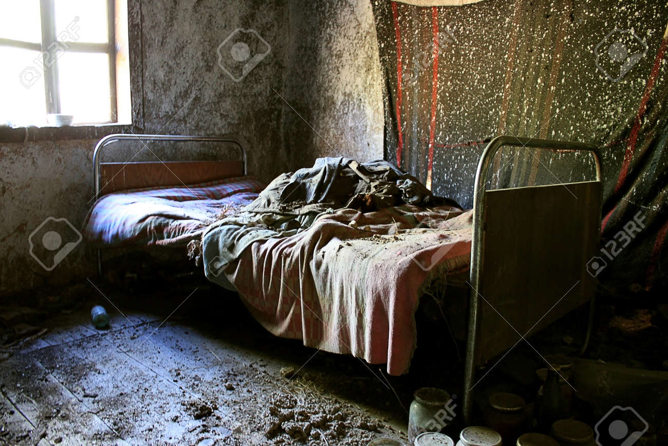 Bedroom With Iron Bed Old Blankets And Dirty Interior In An