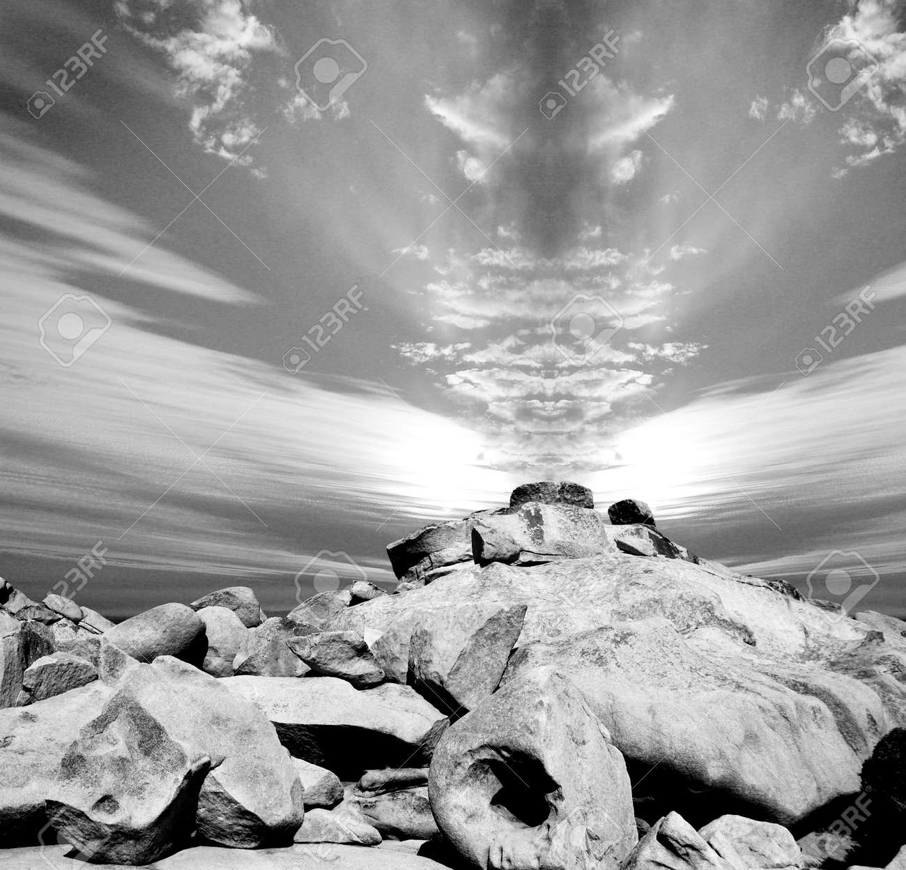 Composite image of rays of sun, clouds and rocky formation Stock Photo - 4021178
